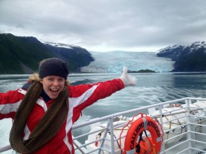 Kari in front of a glacier at the end of her Alaskan experience.