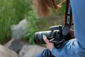 Stephanie, viewing the world through her camera. Photo credit to Leah Renaud.