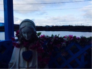Our new home for the next two weeks is at the Catholic Church. A statue of Mary sits right outside the Church with a view of the small pond right by the Church. Photo by Kari Welniak
