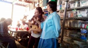 Natalia performing at the Commodor for migrants who were recently deported. She invited them to sing along with her and their spirits were immediately lifted.