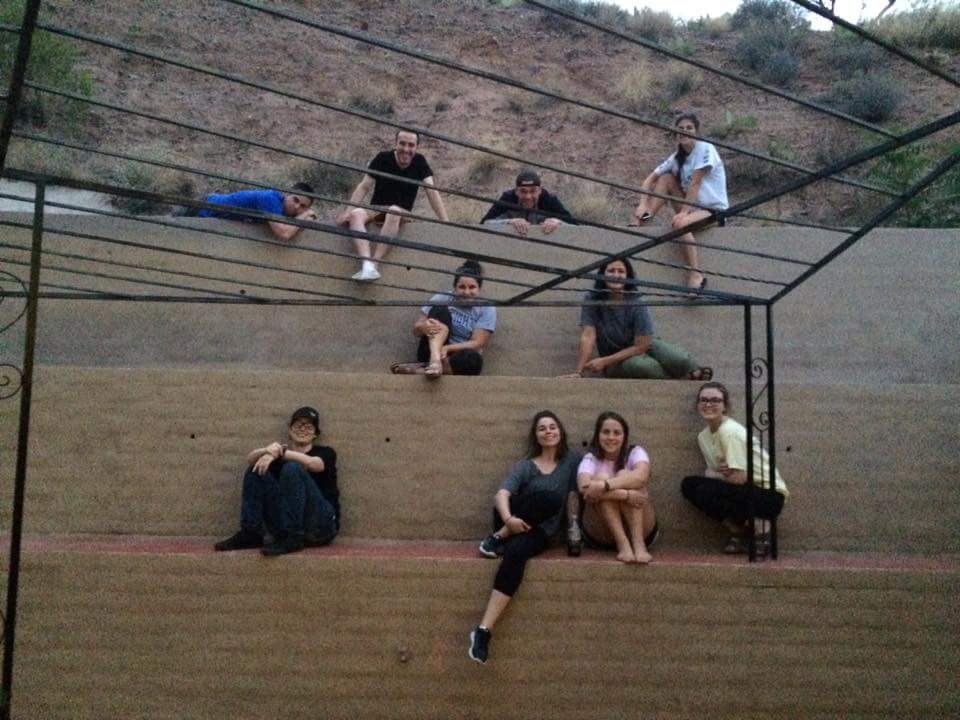 Several Backpack group members sitting on the wall behind our guest house in Nogales, Arizona